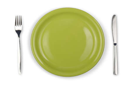 Knife, green plate and fork isolated Stock Photo - 7422350