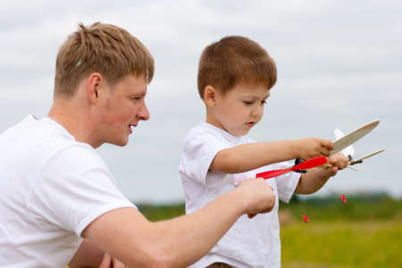 Father and son have fun with toy aircraft model in park Stock Photo - 7526668