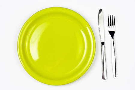 Knife, green plate and fork Stock Photo - 7880317