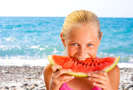 Girl eating watermelon on seashore Stock Photo - 7873026