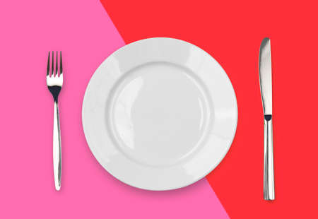 Knife, plate and fork on colorful background Stock Photo - 7880379