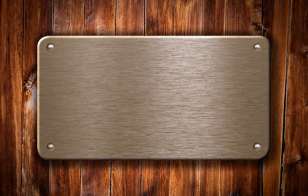 wood plaque: brass metal plate on wooden background