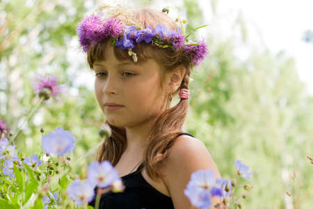 Portrait of girl with flower wreath or crown photo
