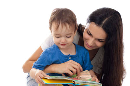 Mother and son reading book together isolated on white photo