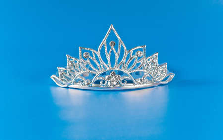 prom queen: Tiara or diadem with reflection on blue background