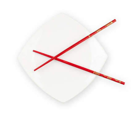 White plate with red chopsticks photo