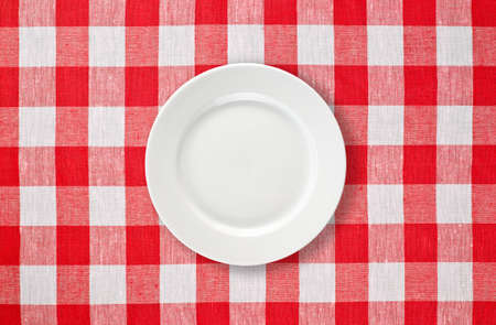 tablecloth: white plate on red checked tablecloth Stock Photo
