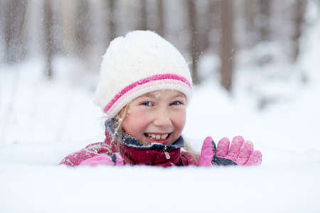 happy little girl look out of snowdrift Stock Photo - 8340194
