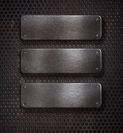 three grunge rusty metal plates over grid background photo