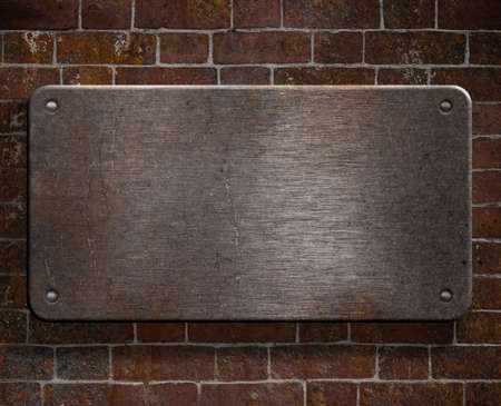 metal template: grunge metal plate with rivets on brick wall background Stock Photo