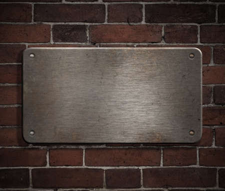 grunge metal plate with rivets on brick wall background Stock Photo - 8980375