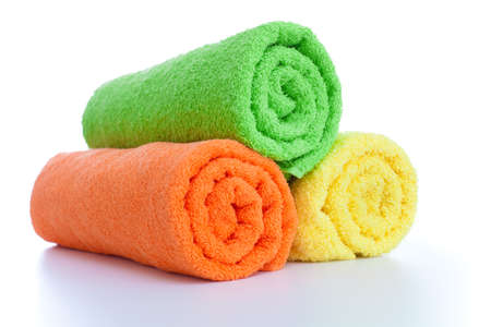 soft textile: stack of fresh colorful towels rolls isolated