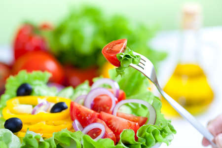 delicious: healthy fresh vegetable salad and fork