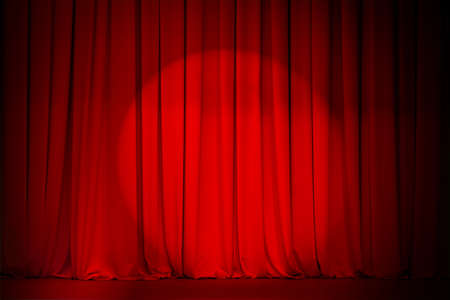 theatre red curtain with spotlight photo