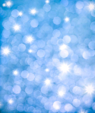 Abstract background of blue glittering lights photo