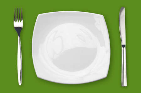 square empty plate fork and knife on green table Stock Photo - 9540284