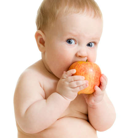 healthy lifestyles: Baby boy eating healthy food isolated Stock Photo