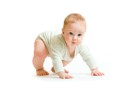 trying: Baby boy toddler isolated trying to stand up Stock Photo