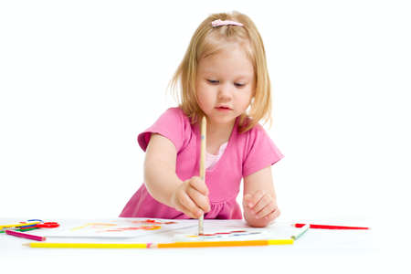 Little girl painting with brush isolated Stock Photo - 9636702