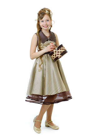 60s fashion: Standing elegant old-fashioned dressed little girl isolated