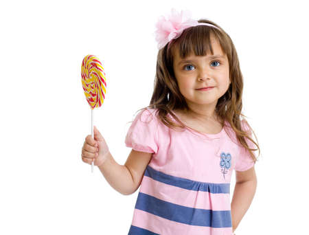 little girl with candy in studio isolated photo