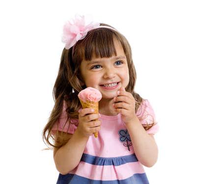 eating ice cream: bambina con gelato in studio isolato Archivio Fotografico