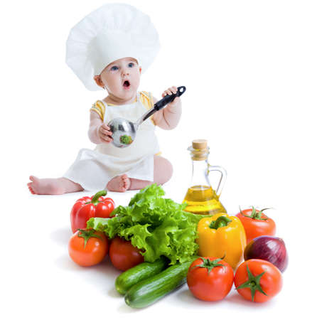 upbringing: baby boy preparing healthy food isolated
