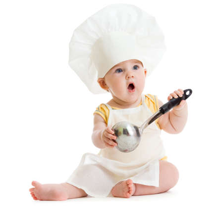 Little boy with metal ladle and cook hat isolated photo