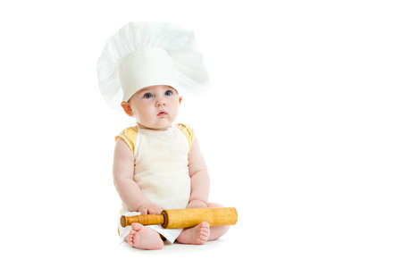Little boy with rolling pin and cook hat isolated photo