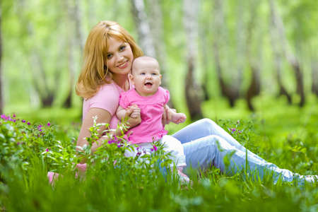 Mother and daughter in birch spring park photo