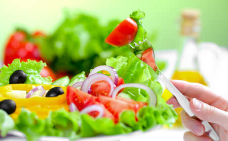 healthy food fresh vegetable salad and fork photo