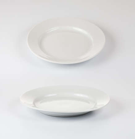 Set of round plates or dishes on white background photo
