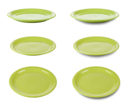 Set of green round plates or dishes isolated on white