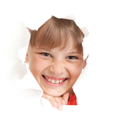 happy kid or child smiling face in torn paper hole isolated photo