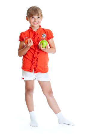 Schoolgirl portrait holding apples isolated photo