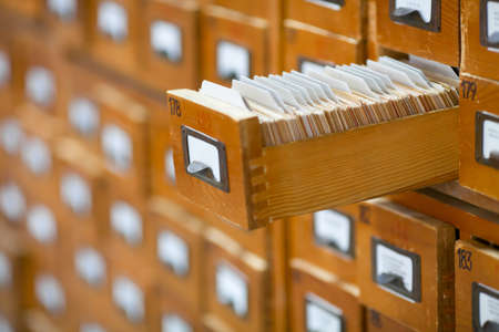 database concept. vintage cabinet. library card or file catalog. Stock Photo - 10068921