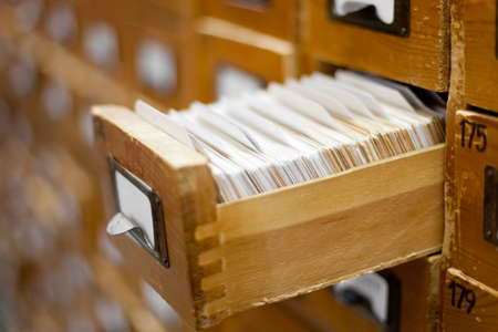 database concept. vintage cabinet. library card or file catalog. Stock Photo - 10438448