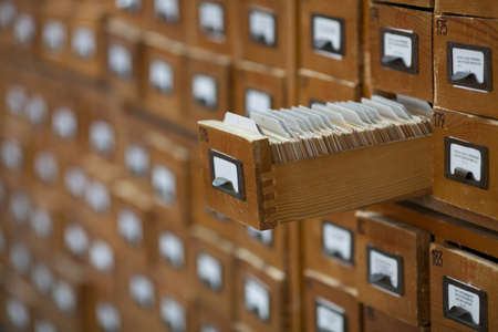 database concept. vintage cabinet. library card or file catalog. photo