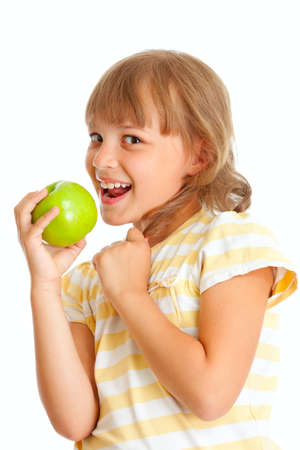 Schoolgirl portrait eating green apple isolated photo