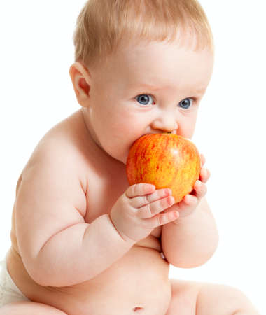 Baby boy eating healthy food isolated Stock Photo