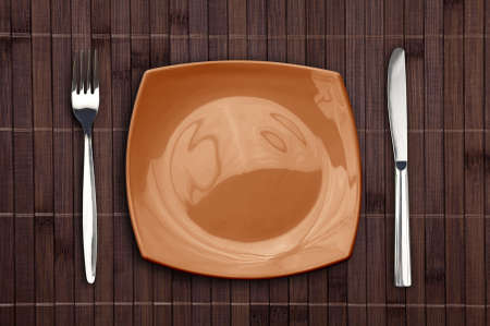 Bamboo placemat with square plate fork and knife Stock Photo - 10669820