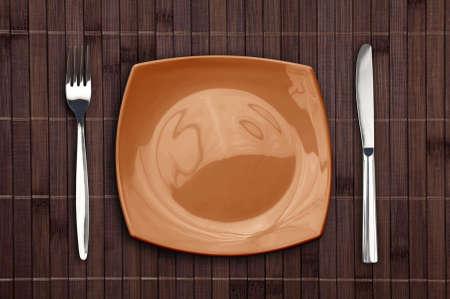 placemat: Tovaglietta di bamb� con piastra quadrata forchetta e coltello