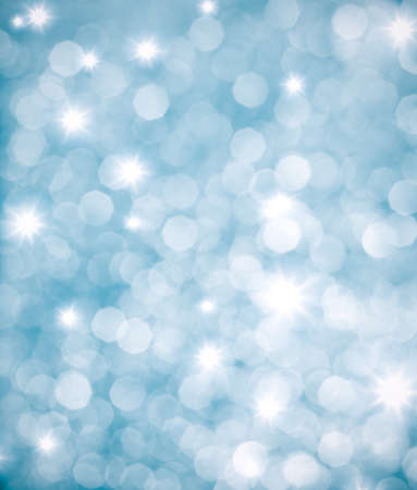 Abstract blue background or glittering lights photo