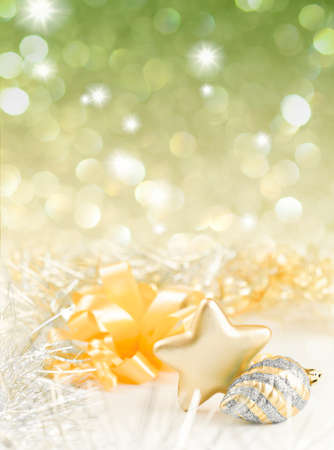 Gold and silver Christmas baubles on background of defocused golden lights Stock Photo - 10776289