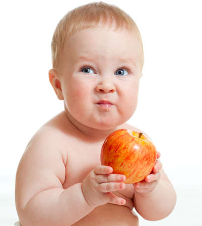 baby eating: Baby boy eating red apple