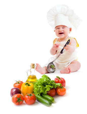 funny baby boy preparing healthy food isolated photo