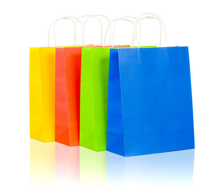 colorful shopping bags set including red, yellow, blue and green on white background photo
