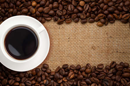 hessian: coffee cup on burlap background