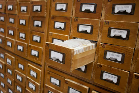 depository: Old wooden card catalogue with one opened drawer