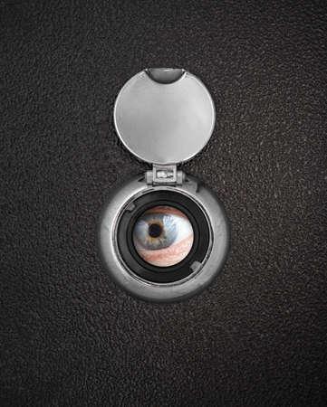 Human eye in peep hole closeup photo
